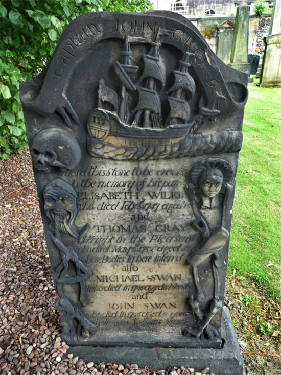 Intricate carving on Captain Gray's memorial at Old Calton Graveyard
