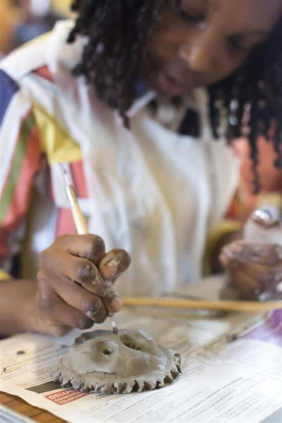 Youngsters learn about the traditional crafts used within the house