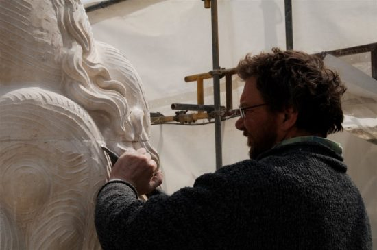 Tim Crawley carves some additonal detail on one of the lions