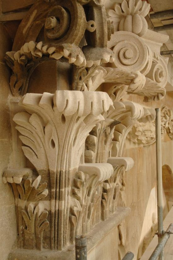This corinthian pilaster required extensive repair with replacement sections being carved to replace failing stonework