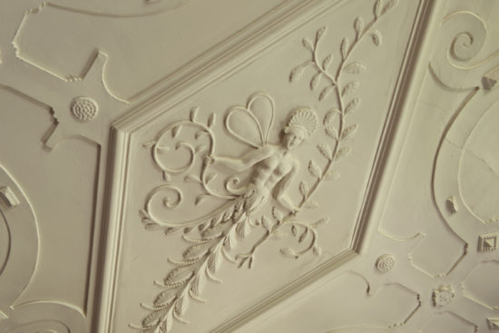 A detail of the plaster ceiling in The Long Gallery