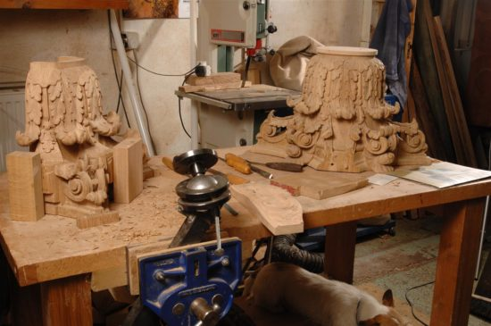 The newly carved captials in the workshop