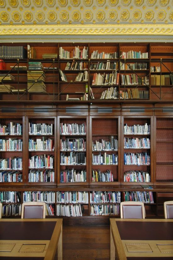 The library shelves were carefully repaired and polished