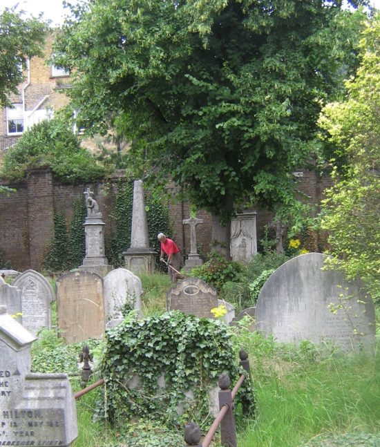 A gardener working in the graveyard