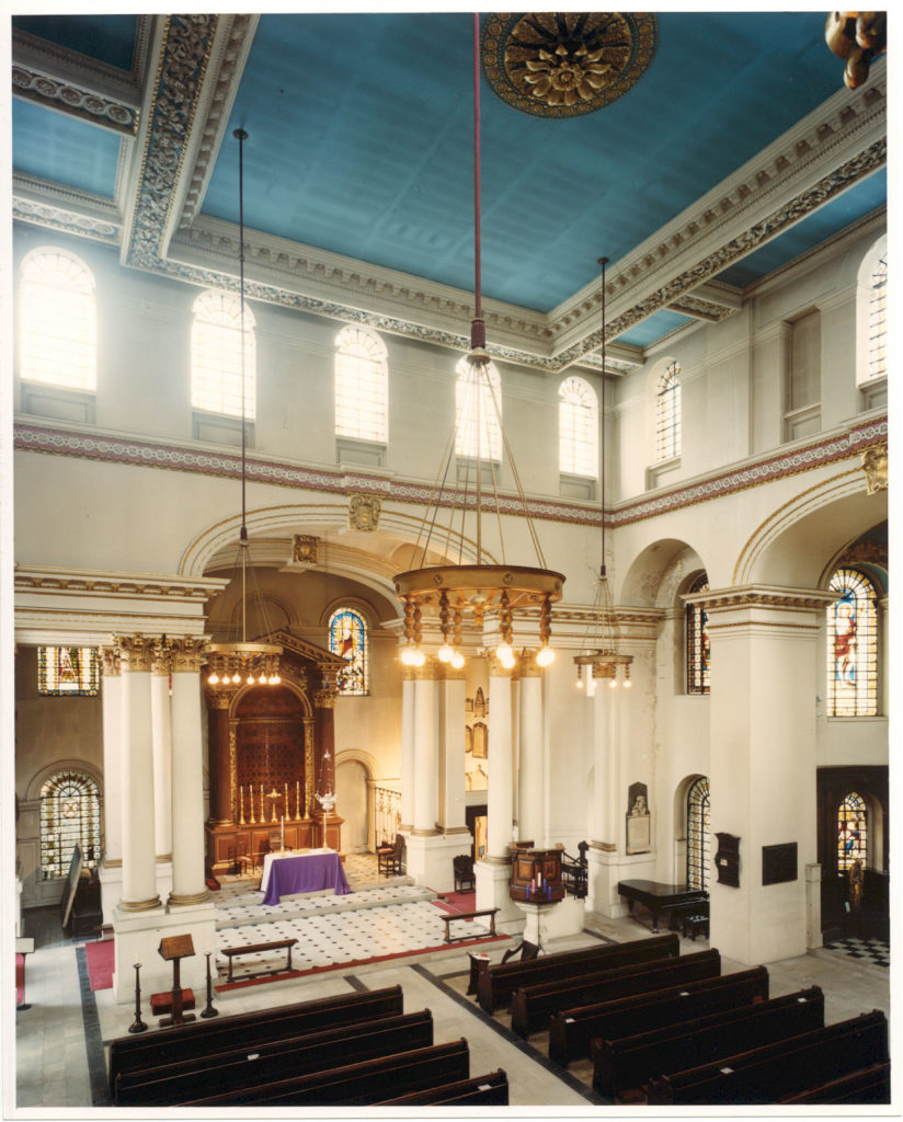 The north-south orientated nave before restoration, showing the blue ceiling and extensive gilding introduced in the early 1970s