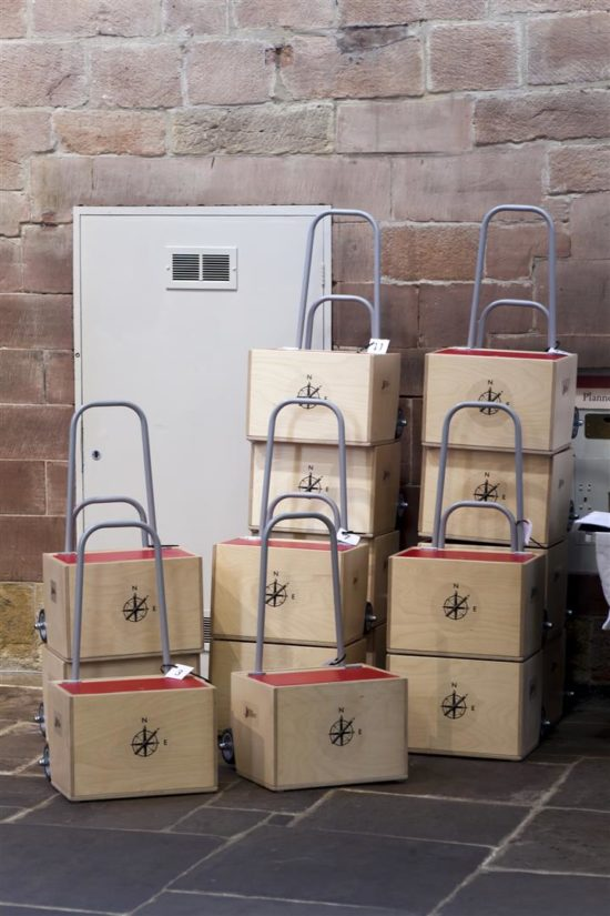 The art carts stacked and ready to go