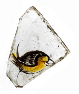 A bird. One piece of Coventry's medieval stained glass collection