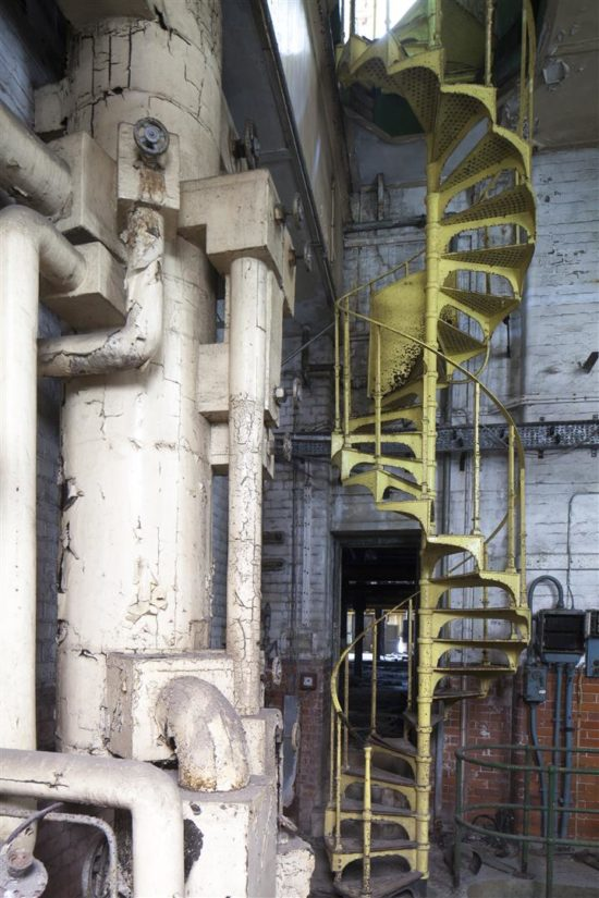 Some of the original pipework and a cast iron staircase