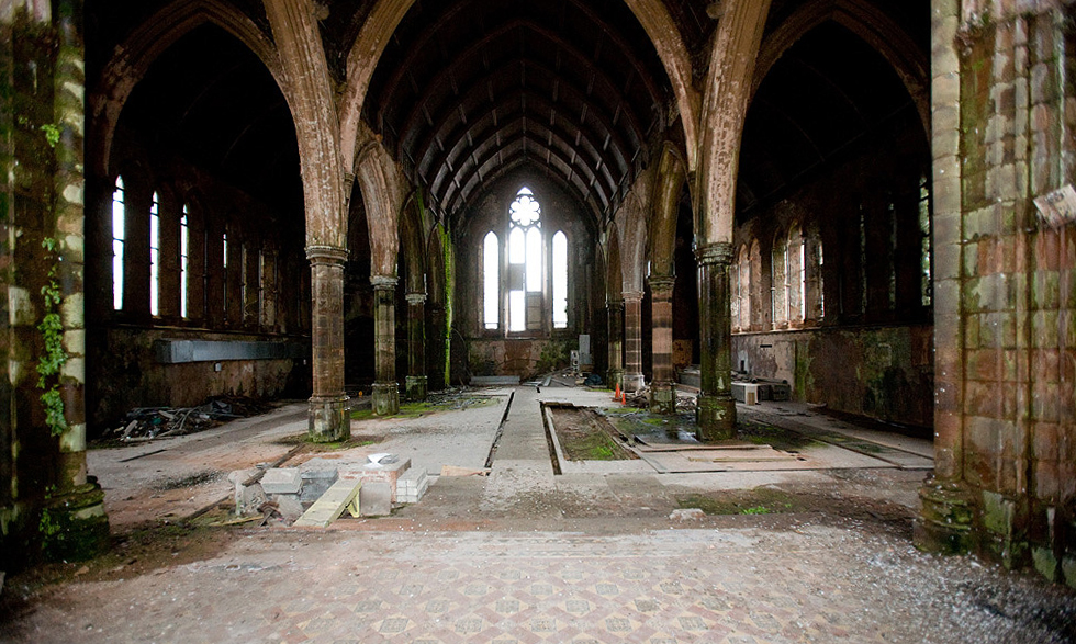 Carlisle Memorial Methodist Church Caption: View from alter to rear, showing damage to floor, stonework, roof and windows with growth on walls.