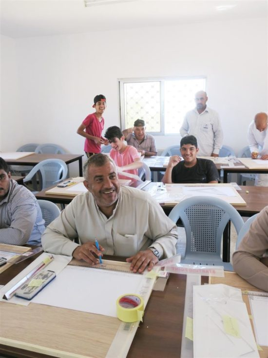The students learning technical drawing in the classroom