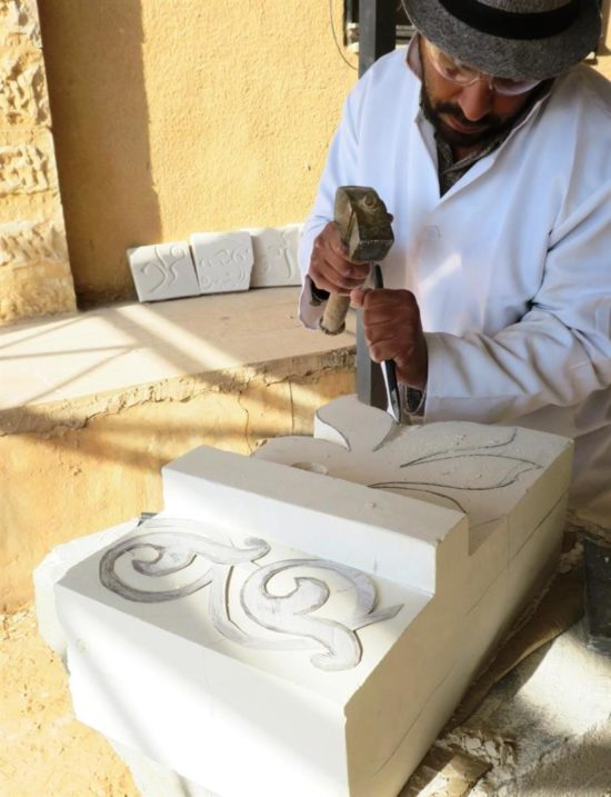A student works on a carving