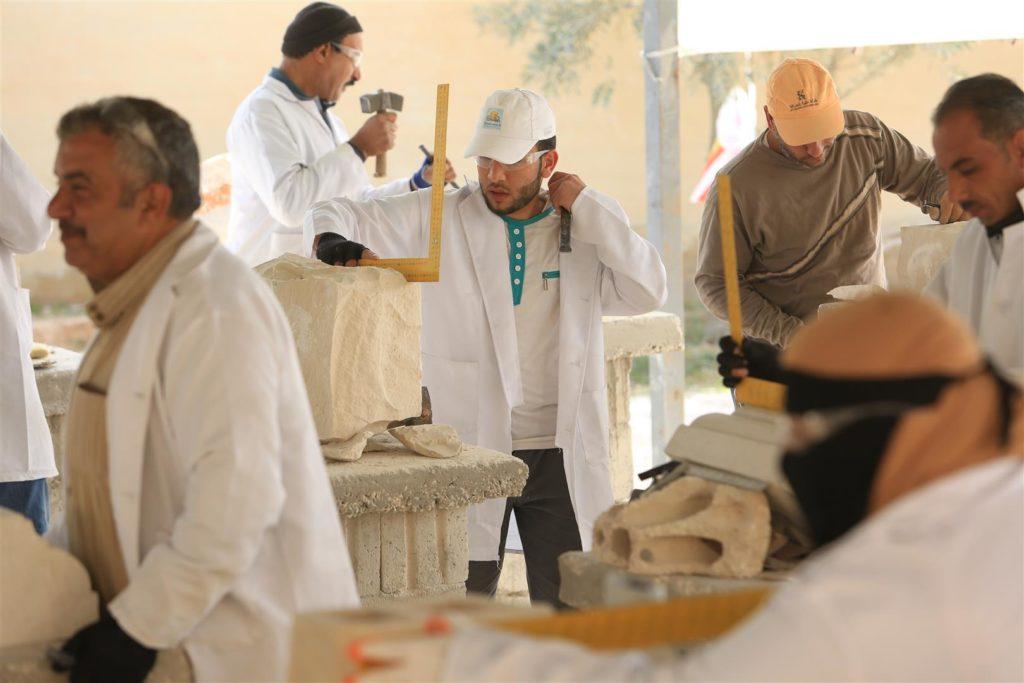 Students working in the stonemasonry training centre in Mafraq