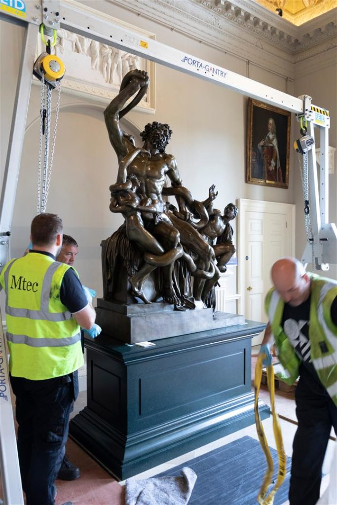 Laocoon is hoisted into position
