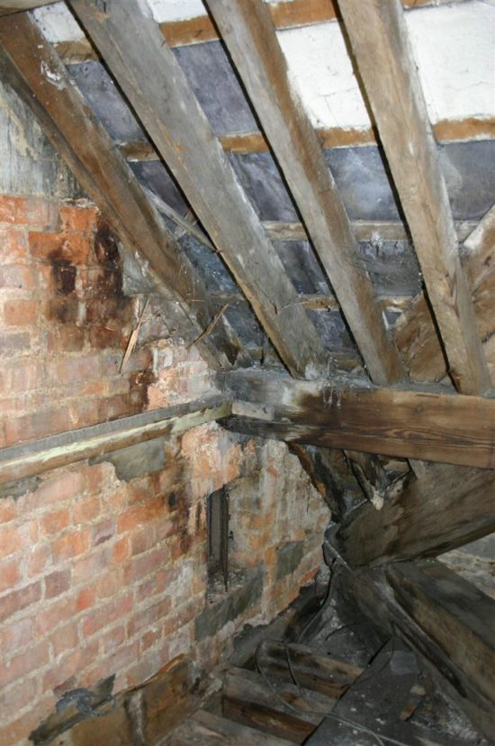Before the restoration began the roof leaked and timbers were rotting