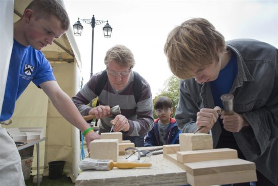 Local people try out traditional crafts at the annual Horn Fair