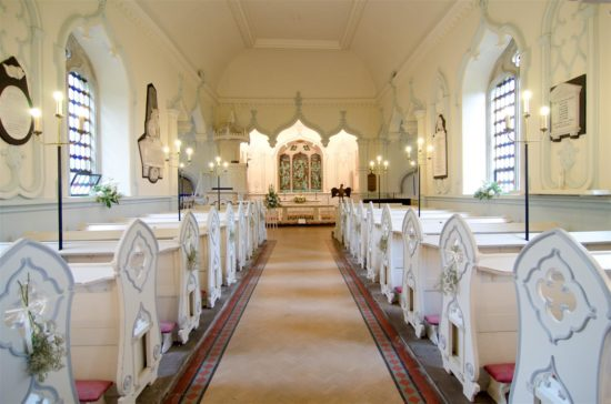 The completion of the Church was celebrated at the Village's annual Food an Flower Festival