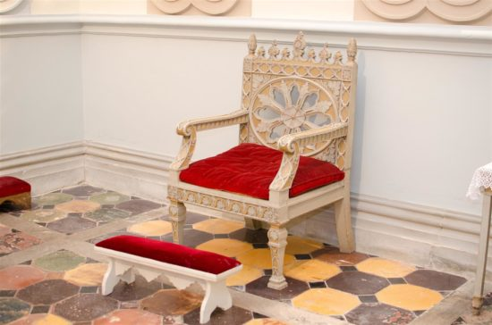 A beautiful chair within the interior of the church