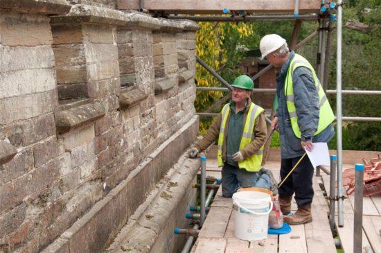 Contractors work on the parapet
