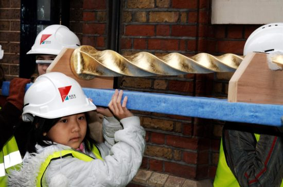 Local school children participated in the topping out ceremony