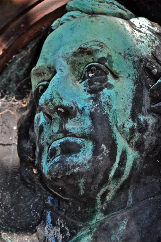 A noble face from St Cuthbert's Kirkyard now stained with verdigris