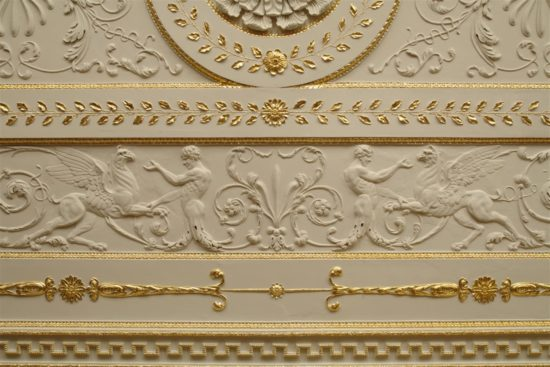 A detail of the newly gilded ceiling