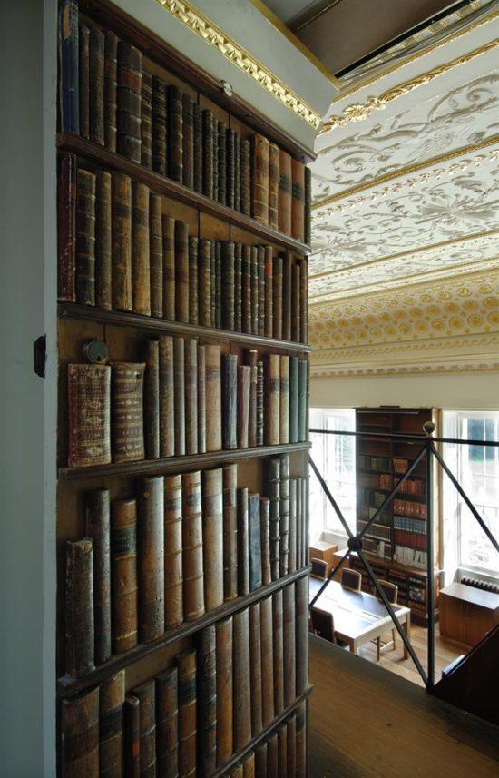 A secret passage is concealed by an imitation bookshelf