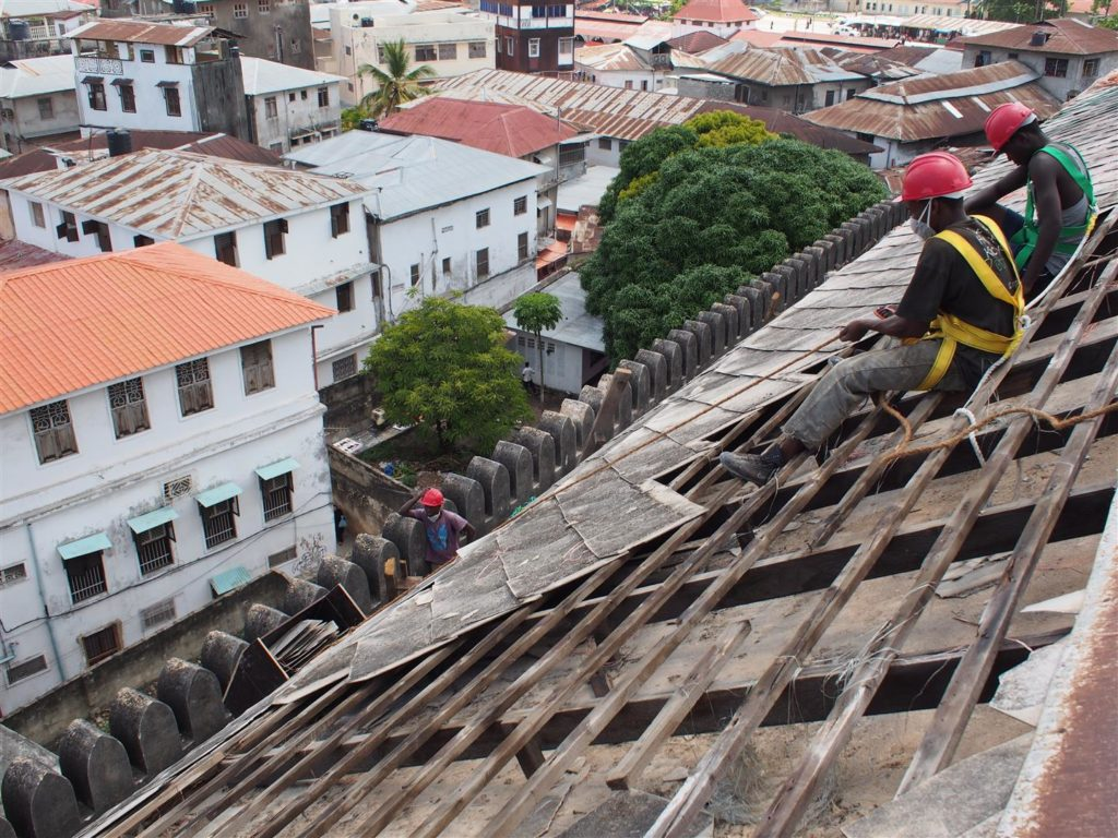 Removing the decayed roof tiles and rafters