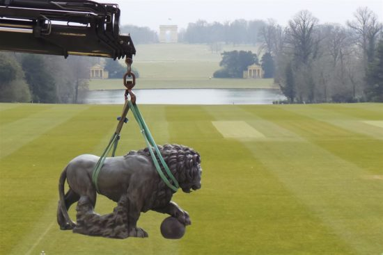 On the misty morning the lions were hoisted into place