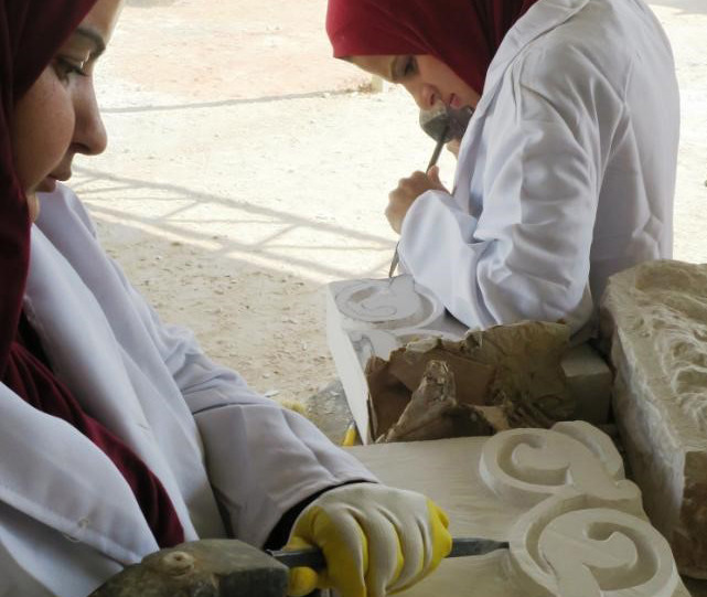 Trainees practicing their carving skills